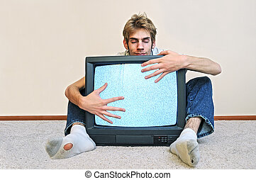 Man hugging his TV