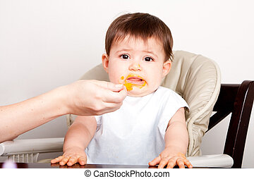 Baby dislikes food - Cute baby infant boy girl expresses...