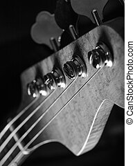 Bass guitar headstock closeup - Black and white photo of a...