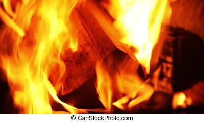 Fire. Burning firewood. Heat. Flame. Burning. The fire in...
