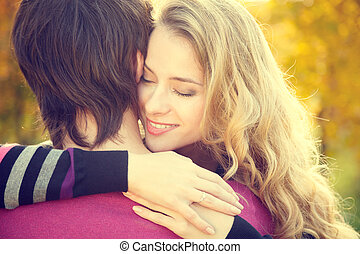 Young Happy Woman Embracing Her Boyfriend on Autumn...