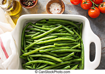Blanched green beans in a baking dish, healthy side dish