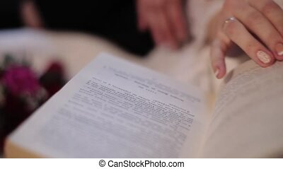 Women hand flipping through a book. Hands in love couple