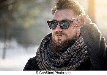 Sunglasses can be useful in winter too - Man in sunglasses...