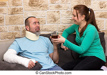 Health care - Man with broken arm and cervical collar gets a...