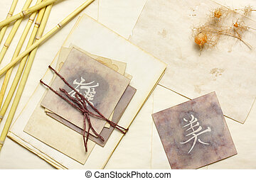 Nostalgic vintage still life with aged cards with japanese...