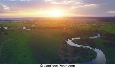 Aerial View: Beautiful river landscape in sunset