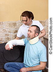 Rehab - An therapist helps a injured man in rehabilitation