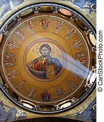 Sunlit painting of Jesus on dome