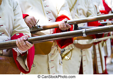 Soldiers firing during the re-enactment of the War of...