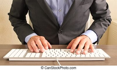 Businessman black suit typing keyboard