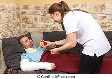 Domestic support - Injured man on the couch gets an apple...