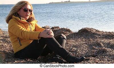 Sad pensive woman on winter sea beach - Thoughtful, pensive...