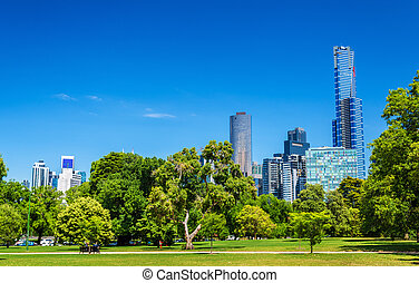 Cityscape of Melbourne from Kings Domain parklands -...