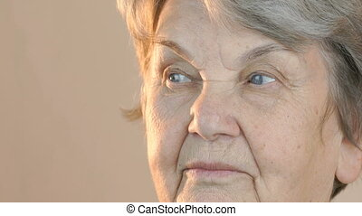 Old woman looking in side. Face close up - Old woman looking...