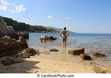 Young sexy woman on the beach, Halkidiki, Greece