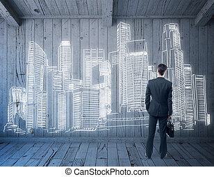 businessman looking on city sketch - businessman in wooden...