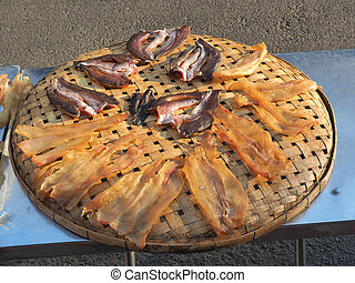 Dried fish on the bamboo grid in the sunny day , Dried fish...