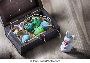 Easter bunny with colorful eggs in a box. - Easter bunny...