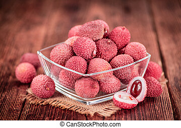 Litchis on vintage wooden background - Litchis on an old...