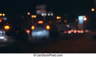 Night traffic on the highway close-up blurred