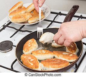 Food patties in a frying pan