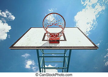 street basketball - under the basketball ring and blue sky...