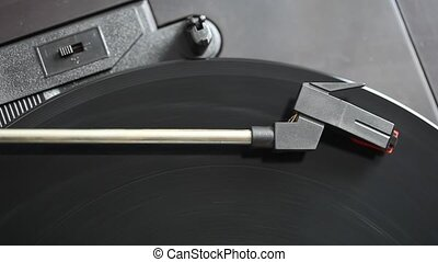 Needle on a spinning record player