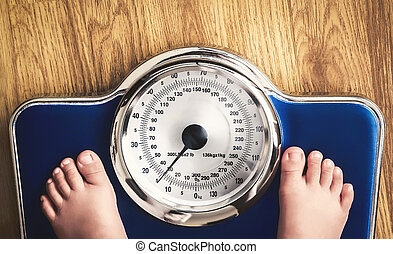 weight scale - kids feet on weight scale