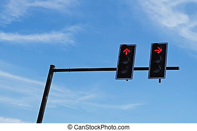 red traffic light against blue sky background
