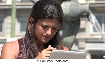Woman Thinking And Confused While Using Tablet