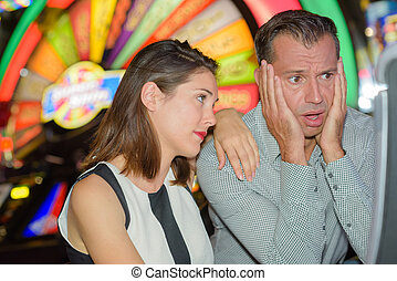 Distressed man after losing on arcade game