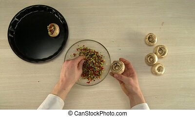 Top view of chef mixes stuffing in glass bowl - First person...