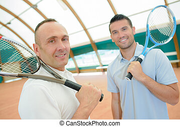 two men with tennis rackets