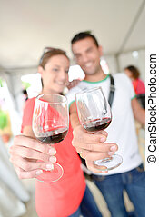 Couple holding up glasses of wine