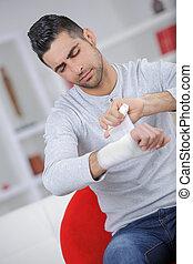 boy keeps broken arm in gypsum plaster arm