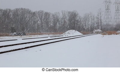 Urban railway system, railway tracks in snow, winter time
