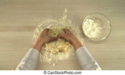 Manual dough kneading. - Manual dough kneading on a table...
