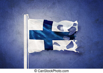 Torn flag of Finland flying against grunge background.