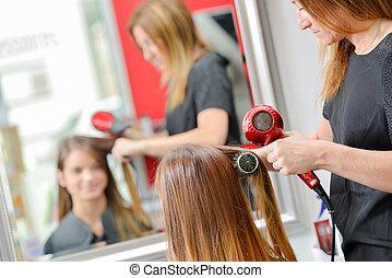Getting her hair cut