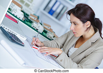 beautiful woman writing a notebook on table