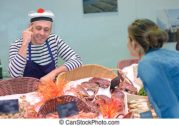 french fishmonger selling fresh fish