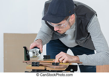 confident handsome young craftsman in workshop