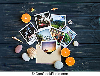 Holiday memories: photos, stones, seashells, fruits on travel photo. Flat lay, top view