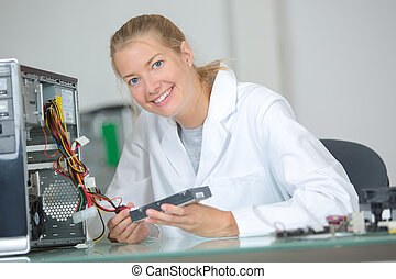 Portrait of female computer technician