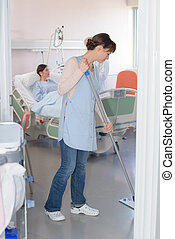 mopping the room