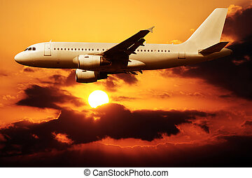 Flying on a sunset - An airplane flying on a sunset in Spain...
