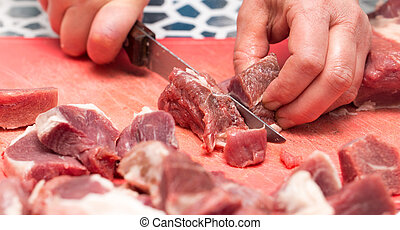 cutting meat with a knife