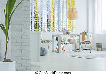 White apartment with dining area
