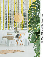 Dining room with wall decor - Dining room with golden and...